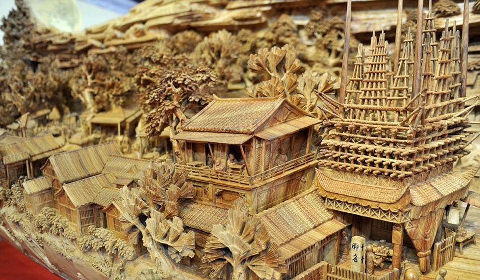 Escultor chinês passa longos 4 anos esculpindo incrível obra prima em madeira 02