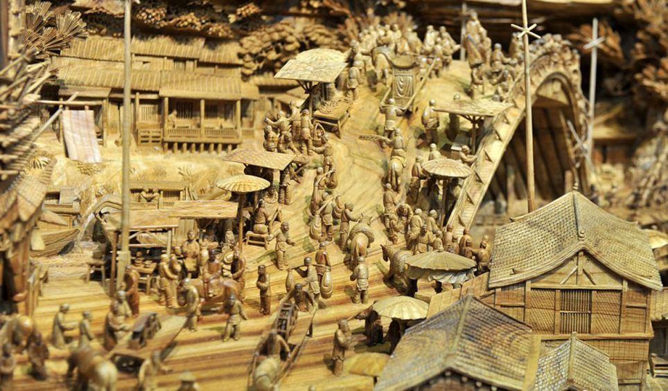 Escultor chinês passa longos 4 anos esculpindo incrível obra prima em madeira 04