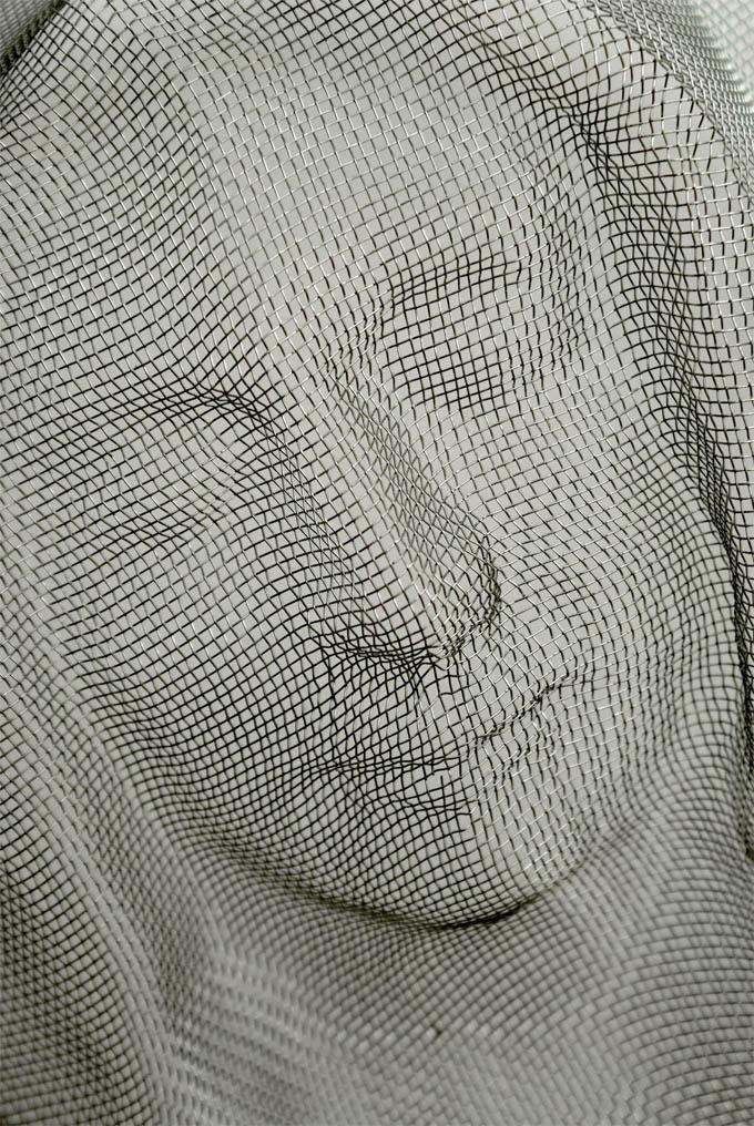 Intrincadas faces sombrias feitas com coadores 05