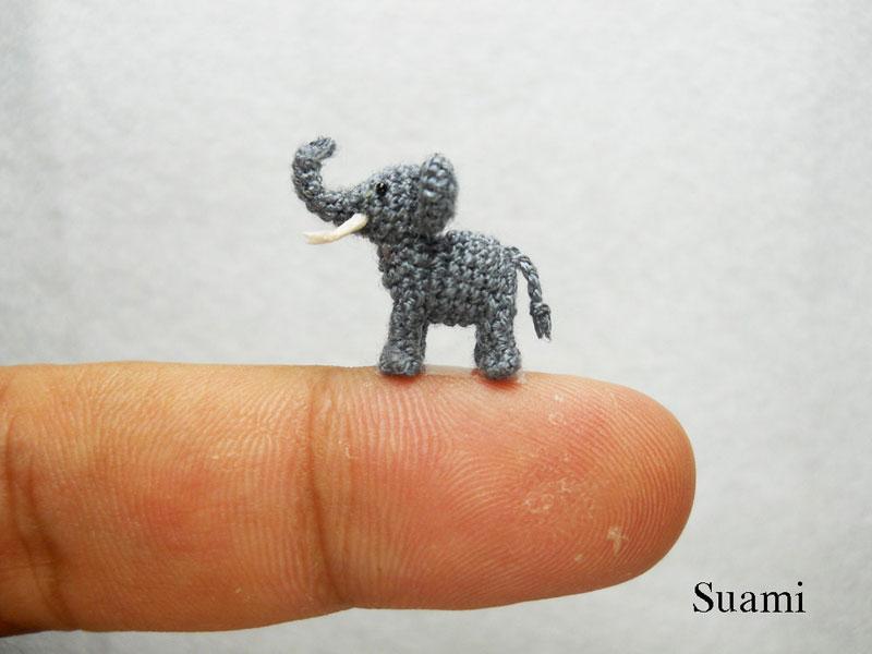 Fam�lia de artes�os vietnamitas cria fi�is reprodu��es de animais em croch� 04