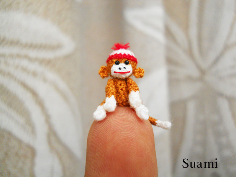 Fam�lia de artes�os vietnamitas cria fi�is reprodu��es de animais em croch� 07