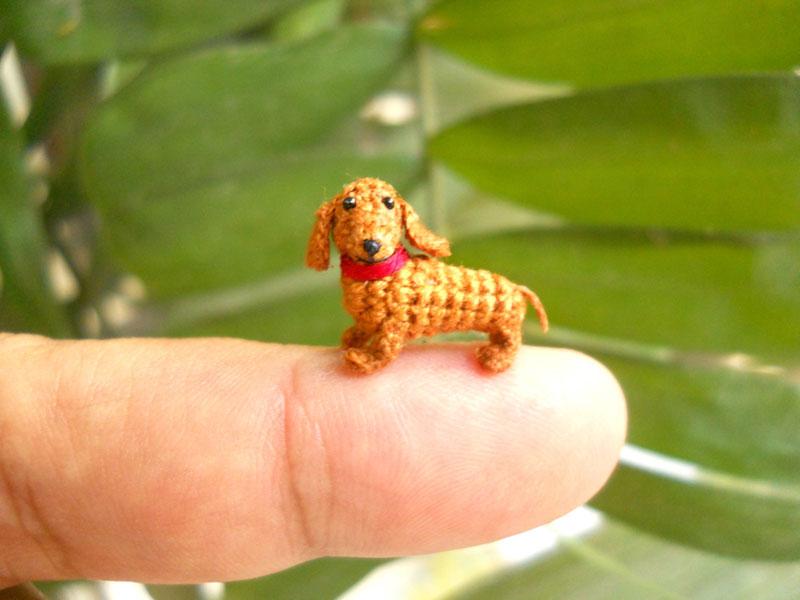 Fam�lia de artes�os vietnamitas cria fi�is reprodu��es de animais em croch� 10