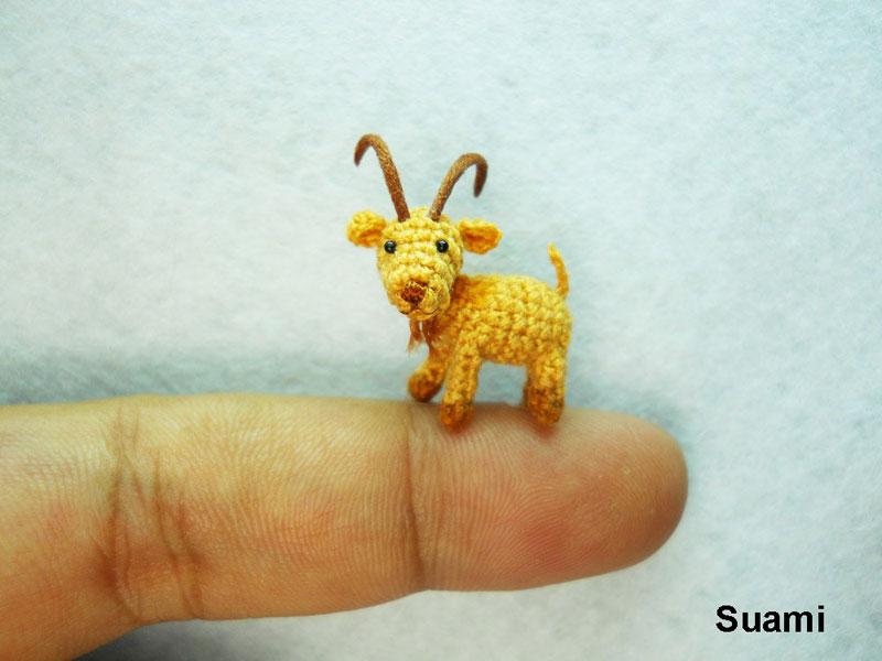 Fam�lia de artes�os vietnamitas cria fi�is reprodu��es de animais em croch� 24