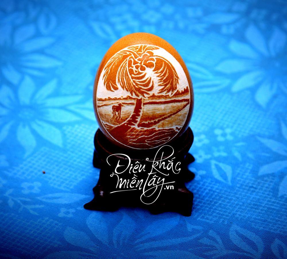 Artista vietnamita esculpe delicados retratos e paisagens em cascas de ovos 10