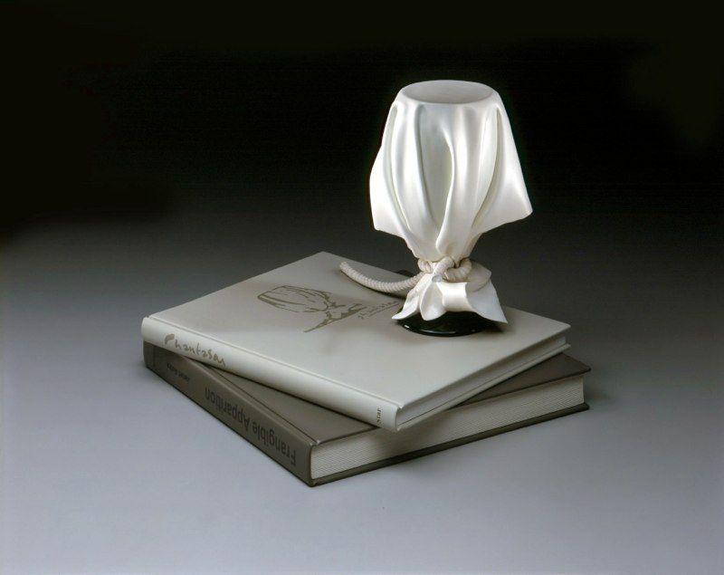 Acredita que essas esculturas realistas são feitas com madeira? 10