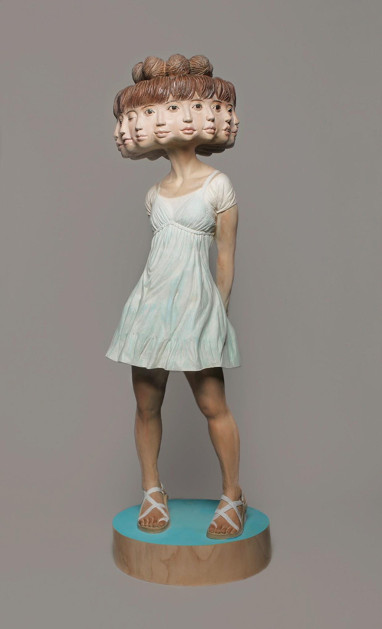 Este escultor japonês mostra como transforma a madeira em estátuas surreais 01
