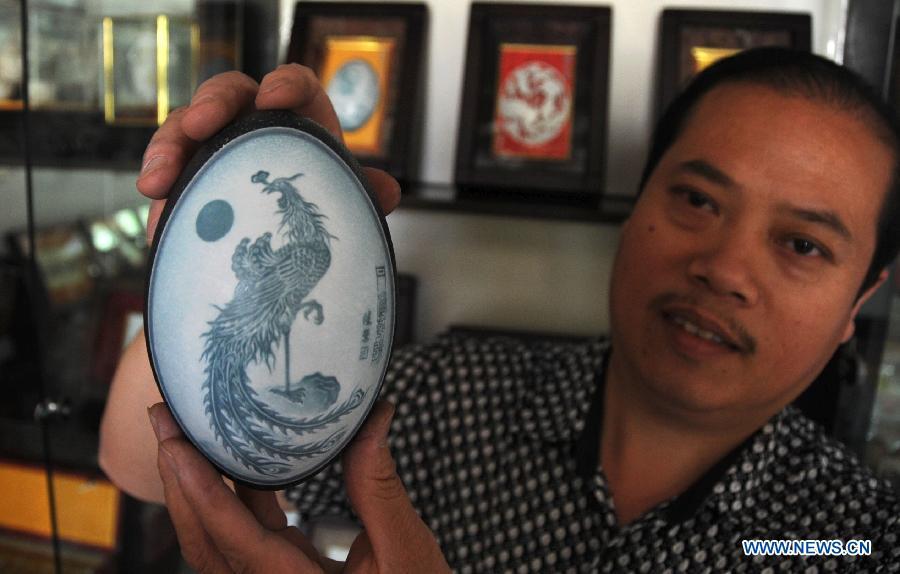 A requintada arte em ovos cinzelados de Pu Derong 03