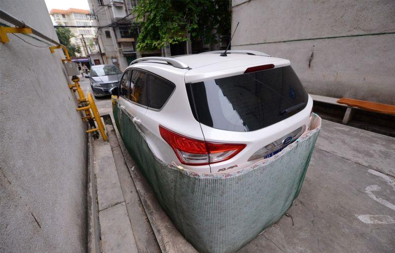 Saiba o que levou os motoristas desta cidade chinesa a tampar assim a seus carros 01