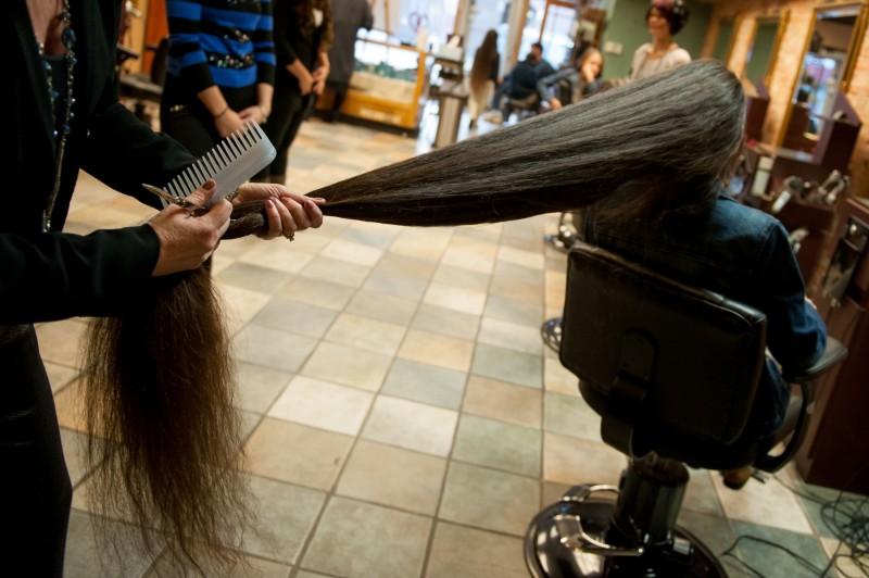 A família Rapunzel, o comprimento combinado de seu cabelo atinge os 4 metros 09