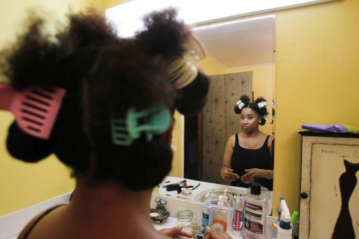 Conheça Aevin Dugas, a orgulhosa dona do maior penteado afro do mundo 02
