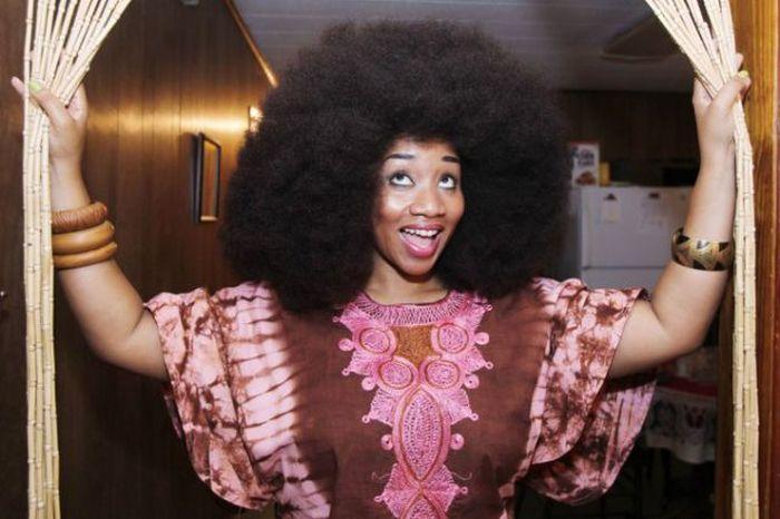 Conheça Aevin Dugas, a orgulhosa dona do maior penteado afro do mundo 20