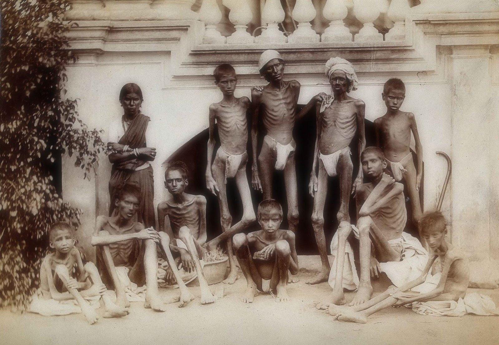 Uma família durante a grande fome de Madras na Índia, em 1876