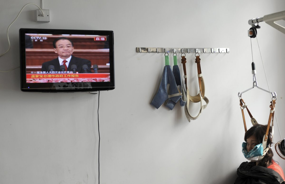 22 fotos impressionantes que mostram como as pessoas assistem TV em todo o mundo 12