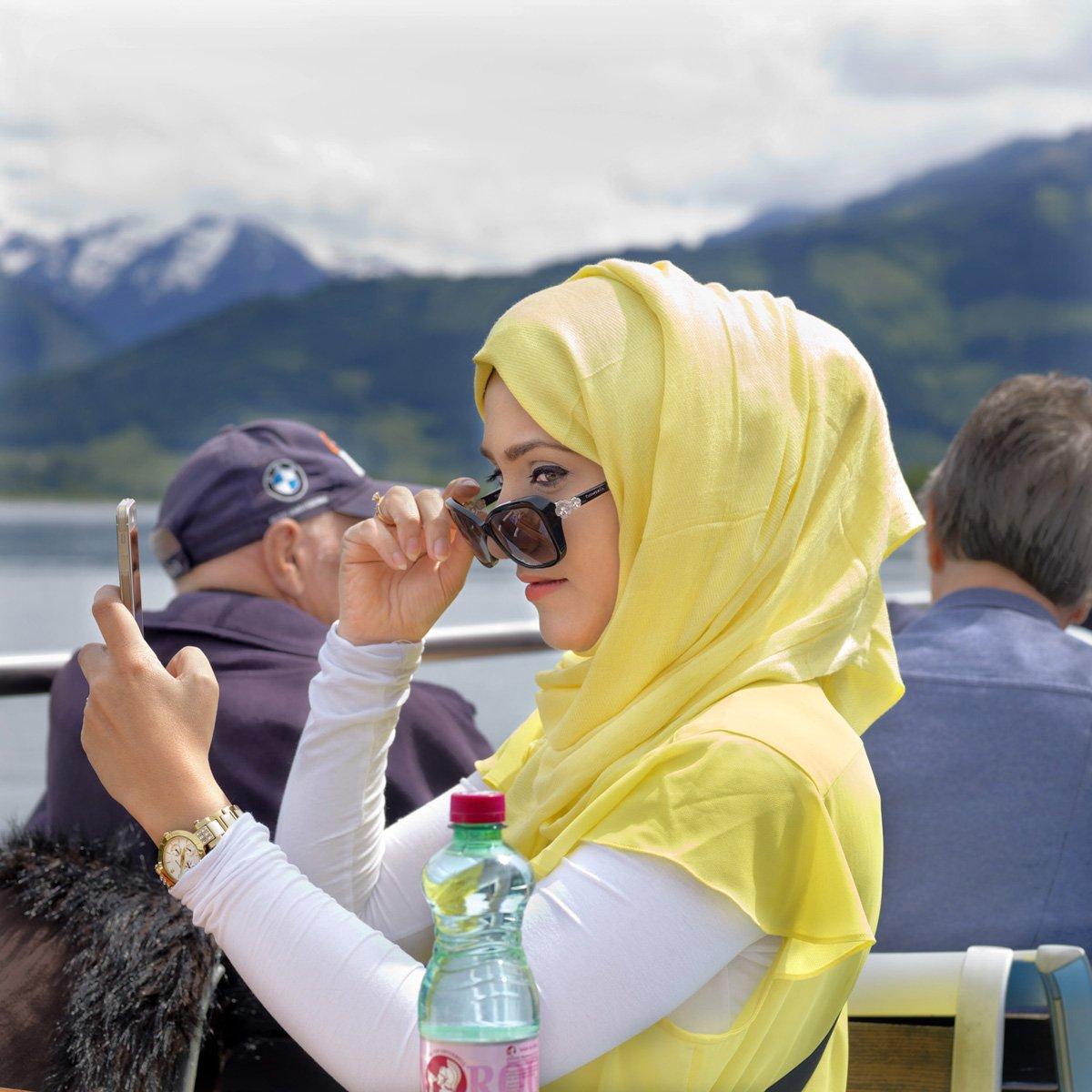 Turistas do Oriente Médio invadem cidade idílica alpina para escapar do calor do verão escaldante 14